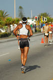 Male triathlete. A male caucasian triathlete running on the road participating in the Ironman  triathlon competition Royalty Free Stock Photography
