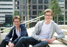 Male twins. Portrait of male twins with glasses smiling outdoors Stock Images