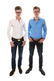 Male twins with white and blue blouse. Standing together Stock Photo