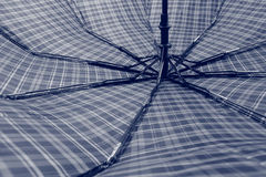 Male umbrella. Men`s umbrella, in expanded form. One can observe the structure and mechanism Stock Photo
