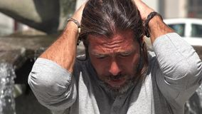 Male Under Stress. A handsome adult Spanish man Stock Image