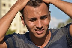Male Under Stress. A handsome hispanic male teen Royalty Free Stock Images