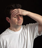 Male under stress and worried on black Royalty Free Stock Photos