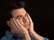 Male under stress and worried on black Stock Photography