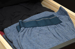 Male underwear in dresser drawer. Male boser shorts in dresser drawer Royalty Free Stock Photo