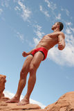 Male underwear model. Athletic, muscular man in red briefs Stock Photos