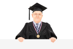 Male university dean posing behind blank panel Royalty Free Stock Photography