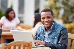 Male University Student Working On Project Outdoors Royalty Free Stock Image