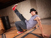 Male Urban Dancer. Handsome Latino male with leg up while break dancing Royalty Free Stock Photography