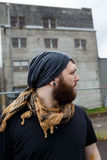 Male Urban Lifestyle Portrait. Young adult man outdoors in an urban environment for a lifestyle portrait of a bearded hipster Royalty Free Stock Images
