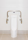 A male urinal with iron bar. This male urinal for accessibility in restroom Royalty Free Stock Image