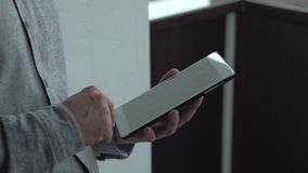 Male using digital tablet. Close - up - hands businessman using a digital tablet for his job stock footage