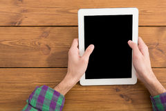 Male using digital tablet, close up, top view Royalty Free Stock Images