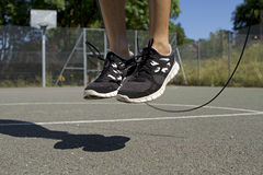 Male Using a Jump Rope. Male basketball player using a jump rope Royalty Free Stock Image