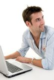 Male Using Laptop. Computer On Floor Royalty Free Stock Photo