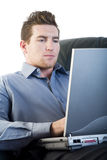 Male using a laptop royalty free stock photos
