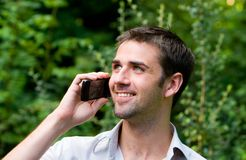 Male Using Mobile Phone. Young male using mobile phone Stock Photos