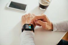 Male Using Smart Watch. Close Up Of Male Using Smart Watch Stock Photo