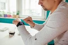 Male Using Smart Watch Stock Photos