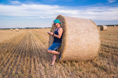 Male using tablet. A young male using tablet on a wheat field Royalty Free Stock Image