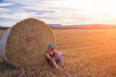 Male using tablet. A young male using tablet on a wheat field Royalty Free Stock Photo