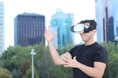 Male using virtual reality glasses in the city.  Stock Images