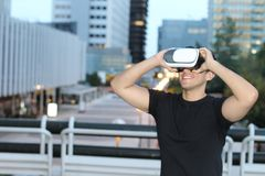 Male using virtual reality glasses in the city.  Royalty Free Stock Images