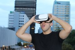 Male using virtual reality glasses in the city.  Royalty Free Stock Photo