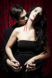 Male vampire is biting a woman with passion Royalty Free Stock Photo