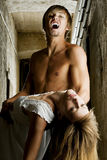 Male vampire is going to bite a young woman. Male vampire is going to bite his female prey. Photo was taken in an old Viennese cellar Stock Image