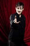 Male vampire reaching for you. His arm is outstretched an you can see his fangs Royalty Free Stock Image