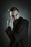 Male vampire showing deadly teeth Royalty Free Stock Photos