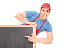 Male vendor pointing on blackboard with finger Royalty Free Stock Photography