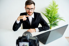 Male video blogger. Young male blogger recording video at home stock photos