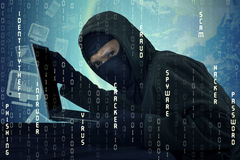 Male villain stealing laptop and user identity. Image of male hacker wearing balaclava, stealing laptop computer and user identity Stock Photos