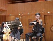 Male violinist xiamen university in performance. Male violinist of department of music of xiamen university in performance, amoy city, china Stock Photo