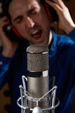 Male Vocalist In Recording Studio. Close Up Of Male Vocalist In Recording Studio Royalty Free Stock Images