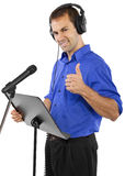 Male Voice Over Artist or Singer. On a microsphone wearing a blue shirt on a white background Stock Photography