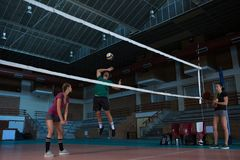 Male volleyball player with teammate jumping. Full length of male volleyball player with teammate jumping at court Royalty Free Stock Photos