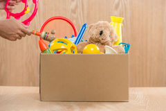 Male volunteer holding donation box with old toys. Royalty Free Stock Photography