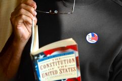 Male voter. A male voter reflects on the Constitution of the United States and what it stands for right after voting in the primary elections for Florida Royalty Free Stock Photo