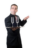 Male Waiter. A male waiter holding a silver tray with two empty wine glasses, isolated against a white background Royalty Free Stock Images