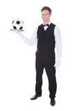 Male Waiter Carrying Football. Portrait Of Happy Male Waiter Holding Football In Tray Royalty Free Stock Photo