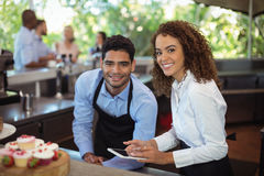 Male waiter and female waitress with digital tablet Royalty Free Stock Photos