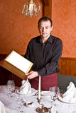 Male waiter with the folder menu at the hands Stock Photo
