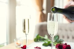 Dining table in restaurant close-up glasses of champagne pouring alcohol stock photo