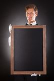 Male Waiter Holding Chalkboard Stock Photo