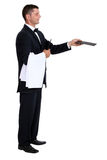 Male waiter holding out menu Royalty Free Stock Photography
