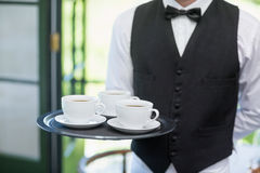 Male waiter holding tray with coffee cups Royalty Free Stock Photo