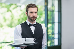 Male waiter holding tray with coffee cups Stock Photos
